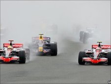 McLaren drivers Lewis Hamilton and Heikki Kovalainen vie for the lead of the 2008 British Grand Prix at Silverstone
