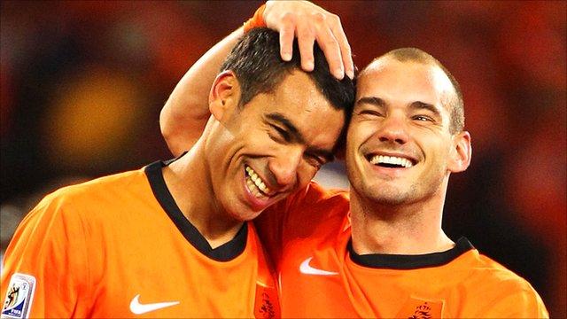 Giovanni Van Bronckhorst and Wesley Sneijder