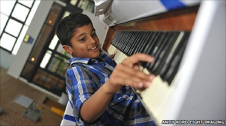 Boy playing a piano