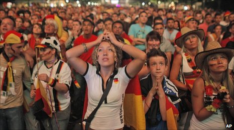 German football fans in Berlin react as they watch the Germany-Spain semi-final
