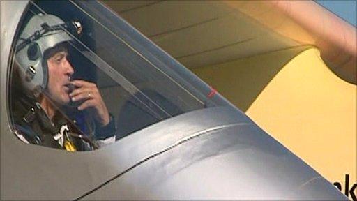 Pilot in solar plane after landing