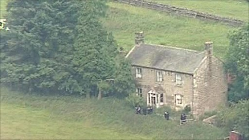 Police surrounding farmhouse