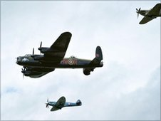 Hurricane, Lancaster Bomber and Spitfire during flypast at RAF Fairford in Gloucestershire