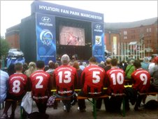 Fans wearing Frank Sidebottom football shirts