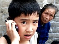 A Chinese boy makes a mobile phone call