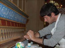 Rob Maybank working on St Edmundsbury Cathedral's organ casings