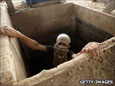 A Palestinian smuggler is seen in a tunnel that runs between Egypt and Rafah