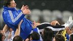Greece's players celebrate after qualifying for the 2010 World Cup