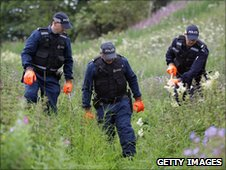 Police officers searching fields for Raoul Moat