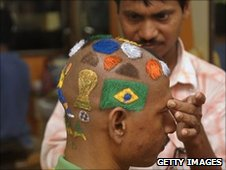 An Indian football fan gets a special haircut