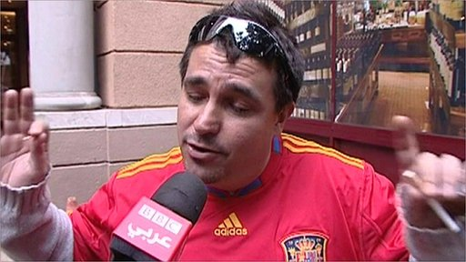 Spain fan gestures to BBC Arabic camera