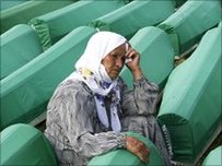 A Bosnian woman mourns over coffins of a newly identified victims of the Srebrenica massacre. Photo: 11 July 2010