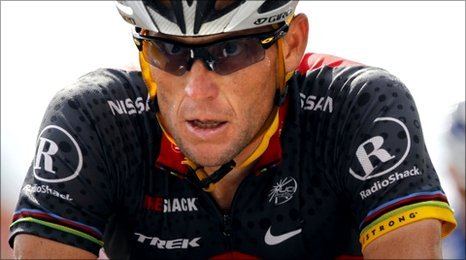 Lance Armstrong of the U.S crosses the finish line of the eighth stage of the Tour de France