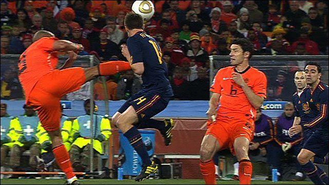 Nigel De Jong lunges at Xabi Alonso