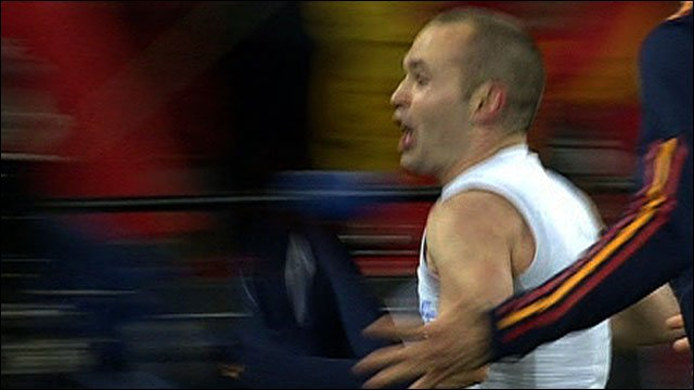Spain&amp;apos;s Andres Iniesta celebrates
