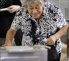 Elderly woman casts her ballot in Tokyo on 11 July 2010