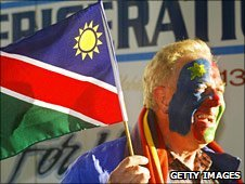 A Namibia fan shows his colours