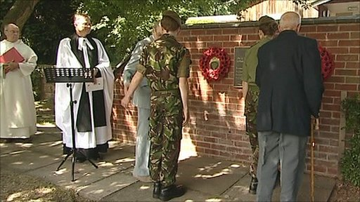Wreaths are placed during the unveiling of a new war memorial in Melbourne