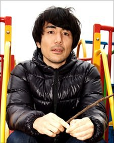 Video games guru Keita Takahashi sitting in the present Woodthorpe Park play area