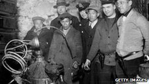 Police raid moonshiners in a New York basement in 1925