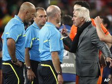 Howard Webb (left) is spoken to by Bert van Marwijk