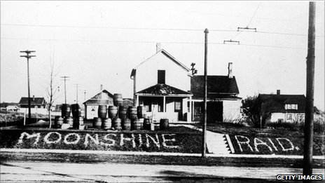 Moonshine barrels line a road in 1925