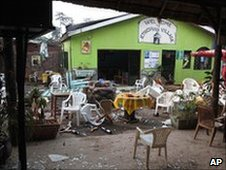 Damaged chairs and tables amongst the debris strewn outside the Ethiopian Village restaurant in Kampala. Photo: 12 July 2010