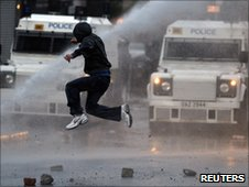 Boy jumps as water cannon deployed