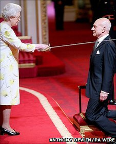 Sir Patrick being knighted by the Queen