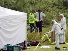Police forensic officers at the scene of the stand-off with Raoul Moat in Rothbury