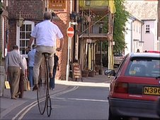 Man riding penny farthing in Knutsford