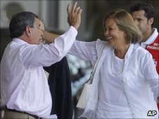 Julio Cesar Galvez Rodriguez greets a woman at Madrid's Barajas airport