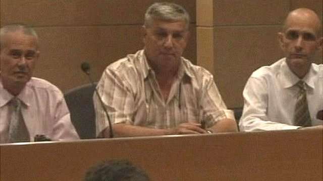 Three Cuban dissidents at a news conference