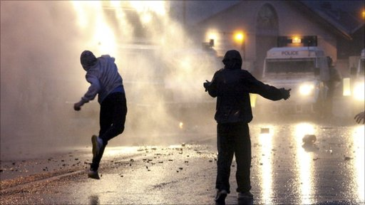 rish nationalist rioters attack Police Service of Northern Ireland officers with water cannon in North Belfast