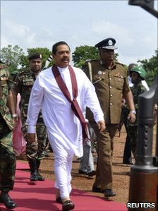 President Mahinda Rajapaksa is escorted by the military to the cabinet meeting