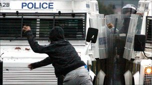Rioter attacks police