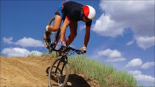 A man mountain biking