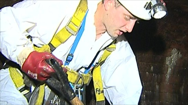 Daniel Brackley from Thames Water digging for fat in London's sewers
