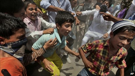 Kashmiri children shout anti-Indian slogans during a protest in Srinagar