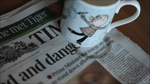 Newspaper with coffee cup and stain