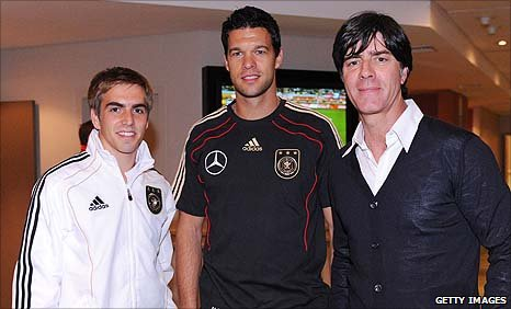 Philipp Lahm, Michael Ballack and coach Joachim Loew