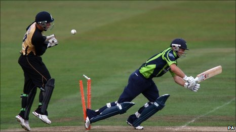 Adam Lyth treads on his stumps