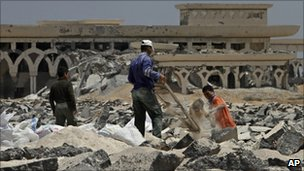 Palestinians collect gravel at the bombed Rafah airport, June 2010