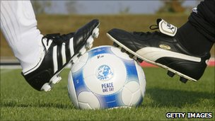 Adidas and Puma staff play football