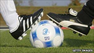 Adidas and Puma staff play football