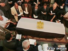 Relatives and friends of Egyptian billionaire Ashraf Marwan, read the holy Koran around his coffin