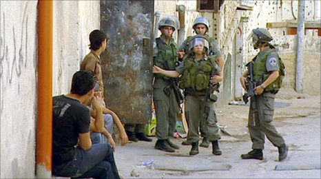 Palestinians and Israeli soldiers in East Jerusalem