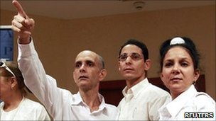 Released Cuban political prisoners Jose Luis Garcia Paneque (left) and Normando Hernandez (centre)