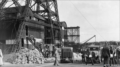 Miners enter the pithead at Gresford Colliery near Wrexham in Wales, with bags of cement to seal off the mine
