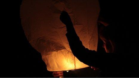 A Chinese lantern being lit